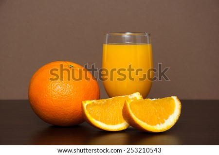 Orange fruit and juice on wooden table