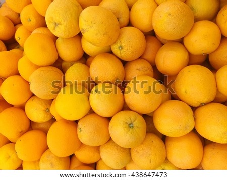 orange fruit background - pile of fresh valencia oranges wallpaper