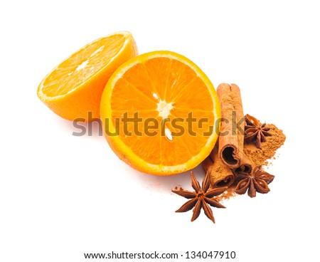 Orange fruit, cinnamon sticks and anise stars isolated on white .Hot drinks ingredients. - stock photo