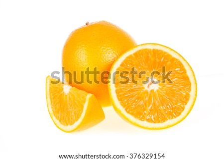 Orange fruit half and two segments or cantles isolated on white background