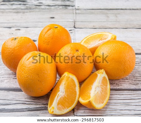 Orange fruit over weathered wooden background