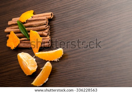Orange fruit segment and cinnamon sticks isolated on white background. Hot drinks ingredients,horizontal photo