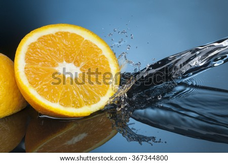 orange fruit slice in water stream - stock photo
