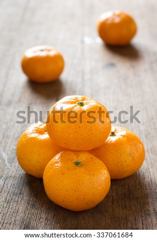 Orange fruits on wood background