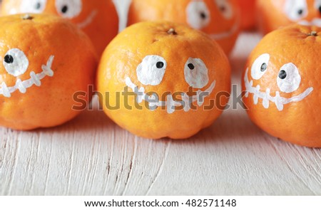 Orange ghost of Halloween, soft focus and color toned.Halloween concept background.