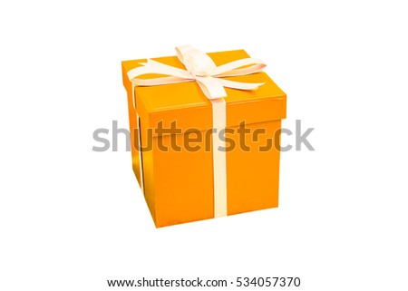 Orange gift box isolated on white background. Christmas present wrapped in ribbon.