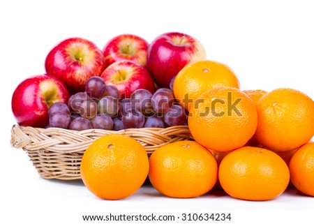 Orange, grape, apple placed on a white background.