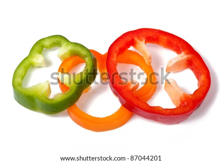 Orange green and red pepper slices isolated on white background with shadow - stock photo