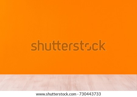 Orange  halloween background with white wooden board, perspective.
