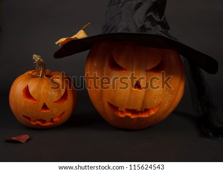 Orange halloween pumpkin on black background