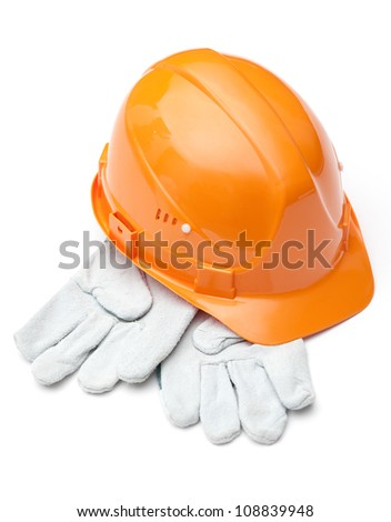 Orange hard hat on white gloves, isolated on white - stock photo