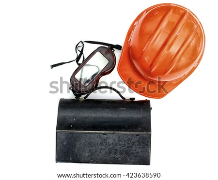 Orange hardhat, goggles and an old, metal lunchbox