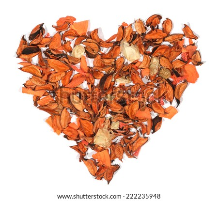 Orange heart from dry flowers, tree on the white background, to the day of Sainted Valentine  - stock photo