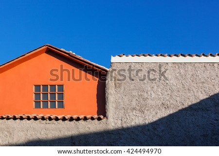 orange house, window and wall on the sky background - stock photo
