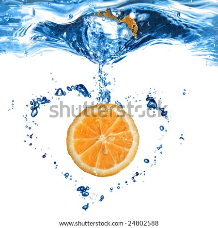 orange in water with bubbles as shape of heart isolated on white