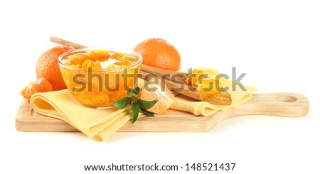Orange jam with zest and tangerines on wooden desk, isolated on white