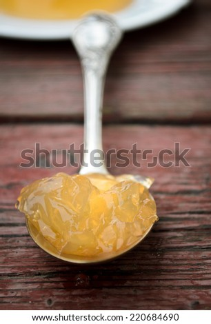 orange jelly with white flowers on a wooden background - stock photo