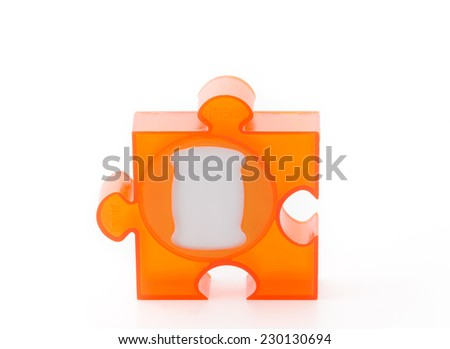 orange jigsaw picture frame on white - stock photo