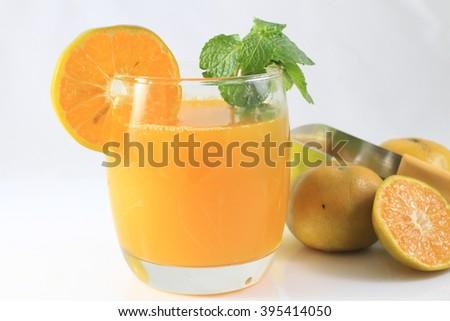 Orange juice and slices of orange isolated on white - stock photo