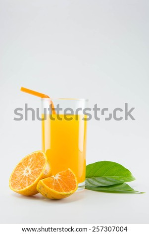 Orange juice and slices of orange on white background.