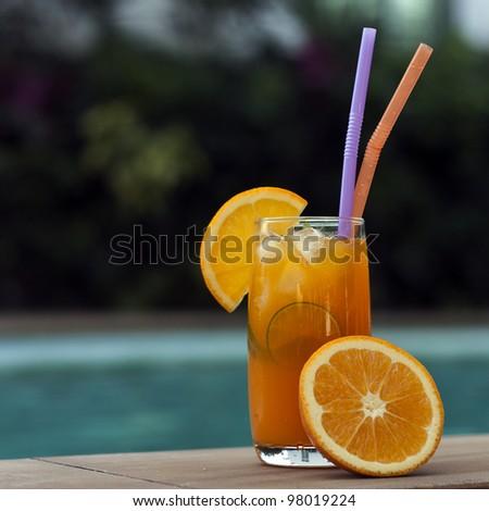Orange juice around a swimming pool - stock photo