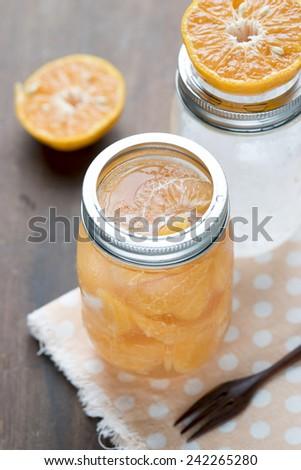 Orange Juice Freshness in Vintage Jar - stock photo