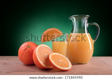 orange juice from oranges - stock photo