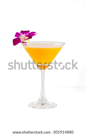 Orange juice in a cocktail glass on white background with orchid flower, clipping path included - stock photo