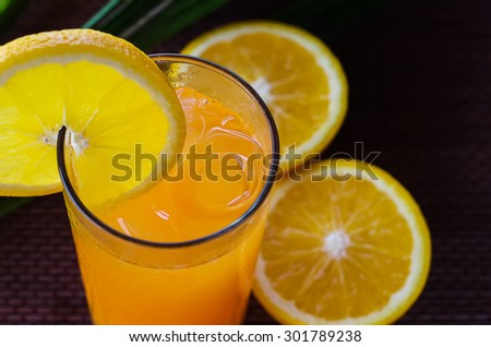 Orange juice in a glass with ice closeup - stock photo