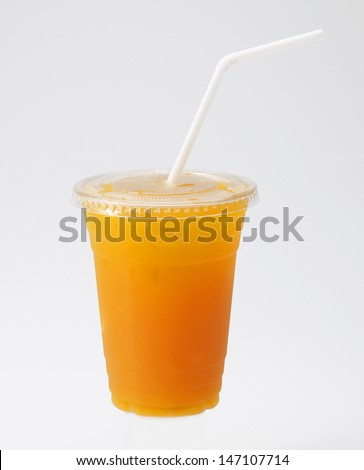 Orange Juice in cup with straw on white background - stock photo
