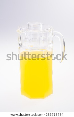 Orange juice in jar. on white background