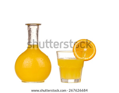 Orange juice in pitcher with orange. Isolated on white background - stock photo
