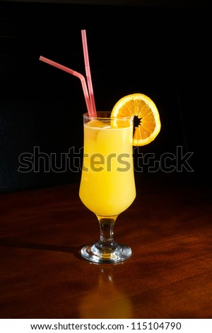 orange juice on a cocktail glass with a slice of orange