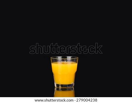 Orange juice on black - stock photo