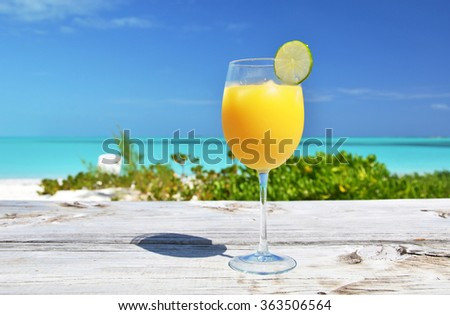Orange juice on the beach. Exuma, Bahamas
