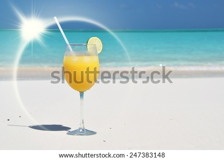 Orange juice on the beach. Great Exuma, Bahamas