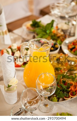 orange juice on the the holiday table with salad; tartlet