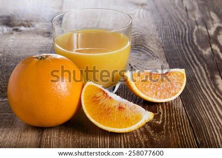 Orange juice on the wooden table - stock photo