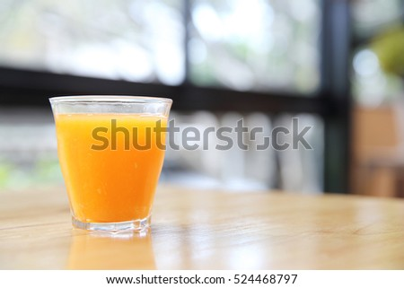 Orange juice on wood background
