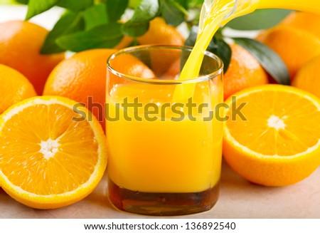 orange juice pouring into glass - stock photo