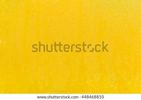 orange juice sweat drops on glass bank container summer lemonade photo fruit - stock photo