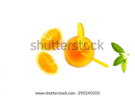 Orange juice with mint and slices of fresh orange top view on white background - stock photo