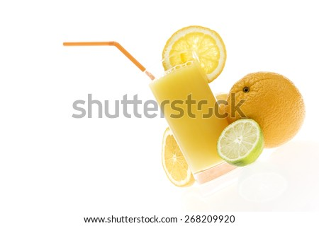 orange juice with slices and whole orange and lime on white background