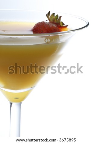Orange juice with strawberry, very close image