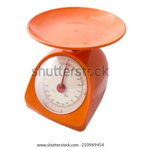 Orange kitchen food scale isolated on white background - stock photo