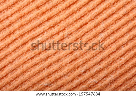 Orange kitchen sponge rubber foam as background texture - stock photo