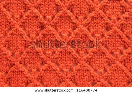 Orange knit background in full frame - stock photo