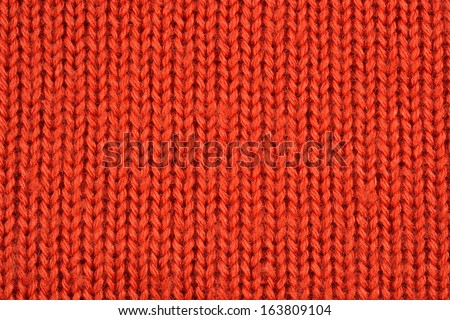Orange knitted fabric texture background - stock photo