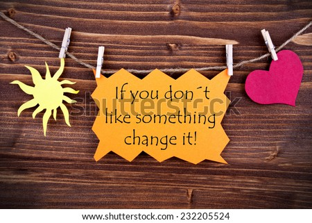 Orange Lable Saying If You Don't Like Something Change It On Wooden Background Hanging On A Line, One Red Heart Symbol And One Yellow Sun Symbol Background Is Old Fashion - stock photo