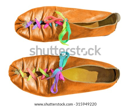 Orange ladies shoes with multicolored shoelaces - stock photo